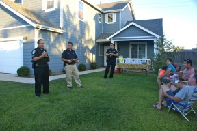 Sanger Police Department officers answer questions from Walton Avenue neighbors. L to R - Sergeant Greg Velasquez, Officer Tom Reinhart and Officer Henry Diaz.