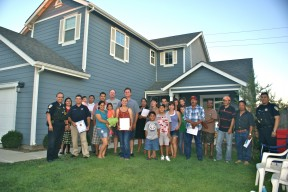 Walton Avenue neighbors gather in front of the home of Andrew and Randra Ratzlaff for a Sanger Community Watch meeting with Sanger Police Department officers.