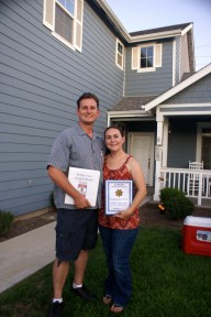 Sanger Community Watch Program Walton Avenue Block Captains Andrew and Randra Ratzlaff, in front of their home, with their program information binder and packet. L to r- Andrew Ratzlaff and Randra Ratzlaff.
