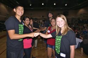 Link Crew Leaders Jacob Bohannon and Bryn Cloud lead their groups in an empowerment activity, during the Sanger High Link Crew rally.