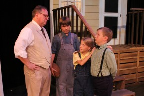 Atticus Finch (CHRIS CARSTEN) shares the wisdom of tolerance with his children (COLIN CLARK-BRACEWELL & BAILEY SHORT) and their friend (CONNOR POFAHL).