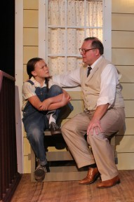 "Atticus Finch (CHRIS CARSTEN) tells Scout (CHELSEA NEWTON) his reasons for defending Tom Robinson.   He explains, ""The one thing that doesn't abide by majority rule is a person's conscience."""