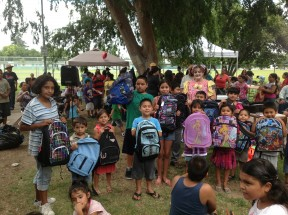 Some of the recipients of the free backpacks