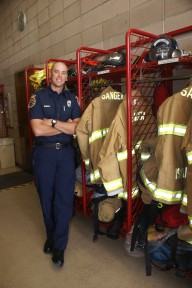 Sanger firefighter/paramedic Andrew Askew stands by his locker where his gear is stored.