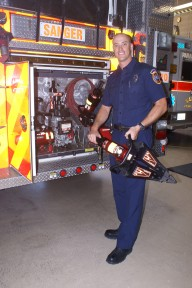 Andrew Askew checks out equipment on the fire engine.