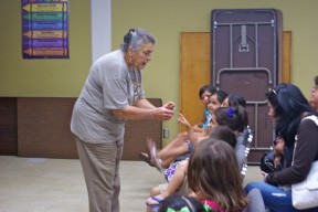 Fresno Chaffee Zoo Docent Burleigh Lockwood shows children a frog figure and talks about reptiles and amphibians