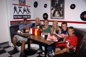 """The Wise family gives the restaurant, food and atmosphere a """"Thumbs Up"""" after eating salads, chili fries and burgers."""