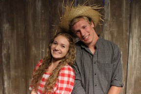 "Becky Thatcher (Megan Fox) and Tom Sawyer (Sam Isaak) celebrate their ""engagement."""