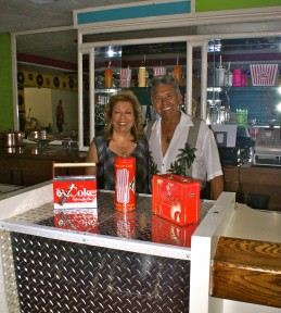 Virginia and Vance Enriquez, owners of The King&#039;s Diner, pose in their Ice Cream Banquet Room.