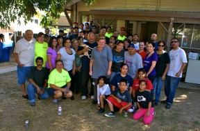 Time In Destiny Christian Center volunteers gather around the Ramos', along with Pastor Paul and Roxanne Zavala, after the home makeover was completed.