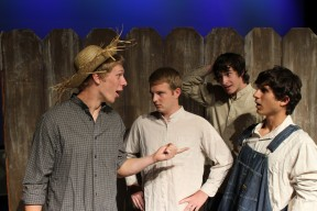 Tom is trying to con his friends into whitewashing the fence for him.   Sam Isaak (Tom Sawyer), Cole Sorensen (Ben Walters), Trent Viau (Alfred Temple), and Chad Balakian (Joe Harper)