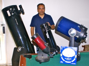 Amateur astronomer Fabian Barajas with his telescopes.