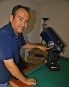 Amateur astronomer Fabian Barajas pointing to telescope gauges which help pinpoint coordinates to view constellations.