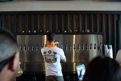 Owner Jason Carvalho maning the beer taps